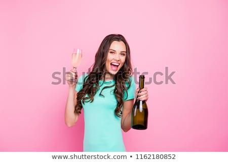 Bájos nő üveg pezsgő boldog fiatal nő Stock fotó © deandrobot