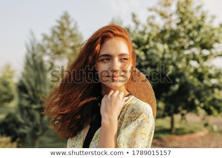 Pretty young woman looking away Stock photo © deandrobot