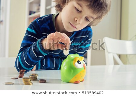 Cute little boy plays with money Stock photo © zurijeta