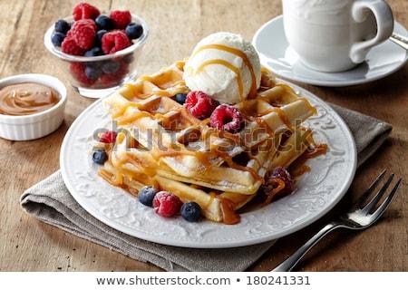 ice cream with caramel sauce and raspberries stock photo © digifoodstock
