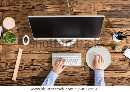 Man using computer mouse, top view Stock photo © stevanovicigor