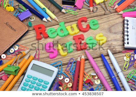 reduce stress text and office tools on wooden table stock photo © fuzzbones0