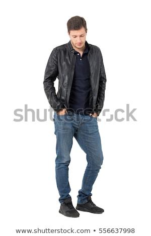 sad fashion man in leather jacket looking down Stock photo © feedough