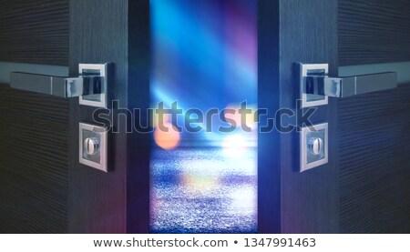 Foto stock: Blue Rays Of Light Behind The Door
