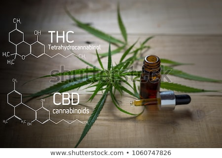 Stock photo: Medicinal cannabis with extract oil in a bottle