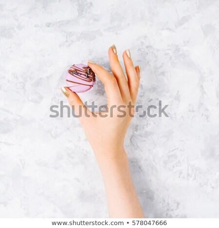 Rózsaszín mandula torta kéz étel háttér Stock fotó © Sibstock