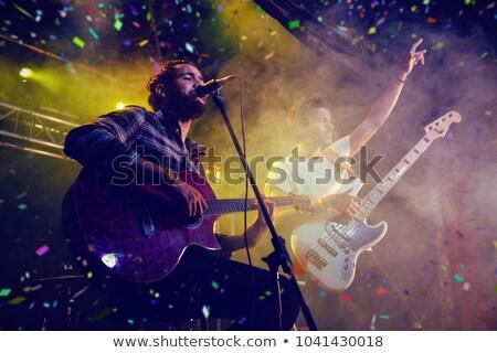 Male singer performing on illuminated stage in nightclub Stock photo © wavebreak_media