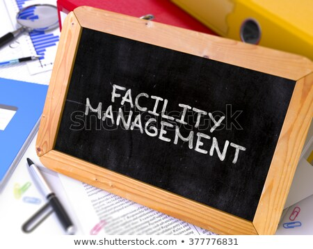Facility Management - Chalkboard with Hand Drawn Text. Stock photo © tashatuvango