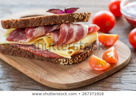 bread sliced with cheese cucumber and dried tomato stock photo © m-studio
