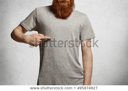 Jóképű férfi mutat póló fehér kommunikáció póló Stock fotó © wavebreak_media