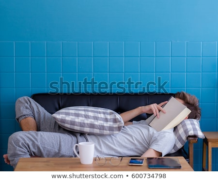 Man sleeping with book on his face Stock photo © IS2