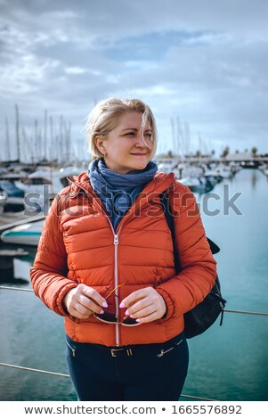 Woman Standing next to yacht Stock photo © IS2