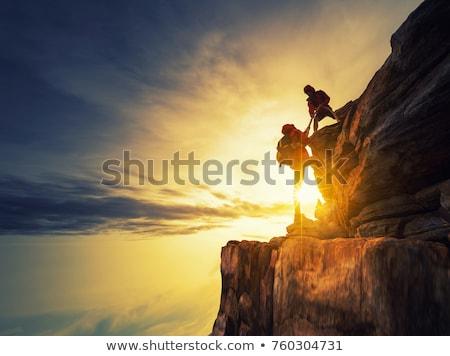udany · turystyka · wspinaczki · sylwetka · góry · człowiek - zdjęcia stock © blasbike