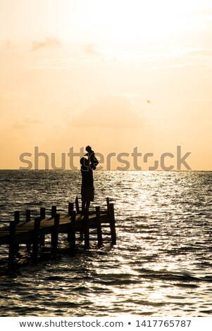 Baby boy on a dock with his father Stock photo © IS2