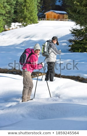 Stock photo: Woman in snowy woods looking to camera