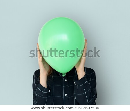 Girl holding balloons in front of face Stock photo © IS2