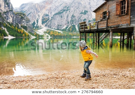 Children skipping stones in lake stock photo © IS2