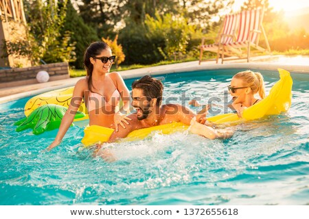 Man relaxing in swimming pool Stock photo © IS2