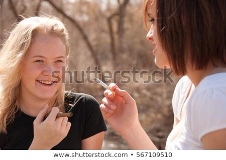 Teenage girl being mischievous Stock photo © IS2