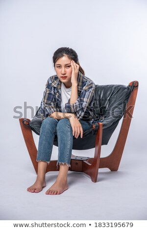Portrait of a young woman sat on a chair Stock photo © IS2