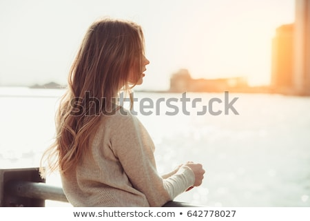 attractive young woman by ocean stock photo © iofoto