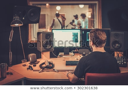musician playing drums at sound recording studio Stock photo © dolgachov