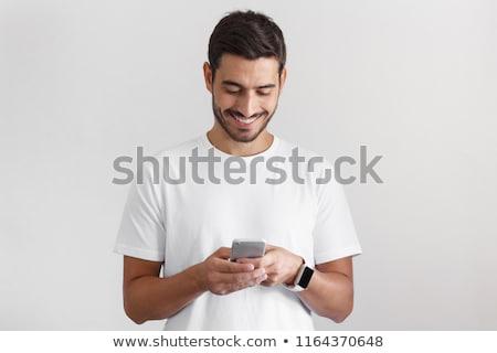 Lezser férfi tart mobiltelefon szerkentyű kéz Stock fotó © robuart