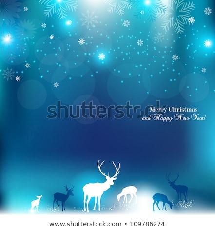 Joyeux Noël bleu glitter rennes forme Photo stock © cienpies