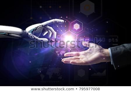 robot and human hand over virtual projection Stock photo © dolgachov