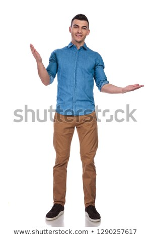 handsome man in blue shirt makes a welcoming gesture Stock photo © feedough