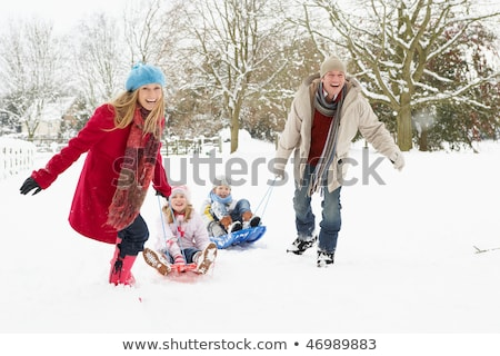 Gyermek fiú húz szánkó tájkép család Stock fotó © Lopolo