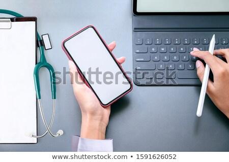 Foto stock: Feminino · médico · branco · comprimido · mão