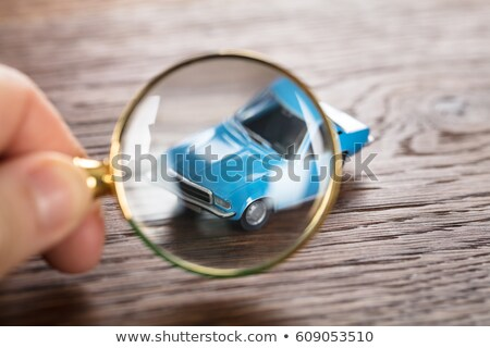 Scrutinizing A Car Model Using Magnifying Glass Stock photo © AndreyPopov