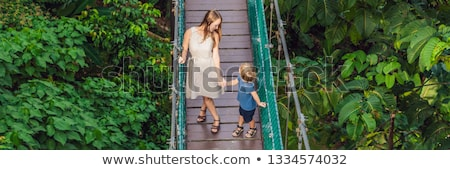 Stok fotoğraf: Mother and son at the Suspension bridge in Kuala Lumpur, Malaysia