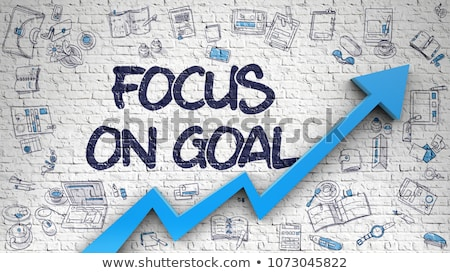 Stock photo: Keep Focus Drawn on White Brickwall. 3d.