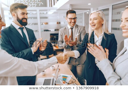 Partners Shaking Hands While Other Colleagues Clapping Stock photo © AndreyPopov