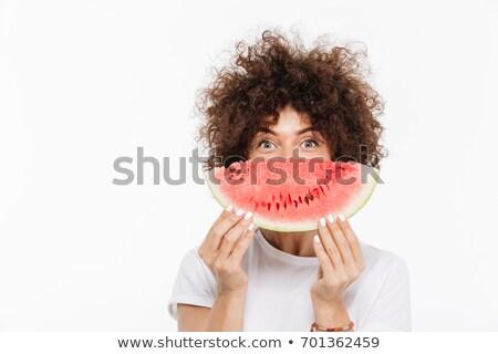 beautiful smiling young woman holding sweet juicy watermelon in hands stock photo © elenabatkova