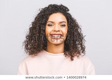 Porträt zufrieden junge Mädchen lockiges Haar halten Stock foto © deandrobot