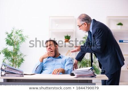 Senior businessman boring his colleagues Stock photo © Giulio_Fornasar