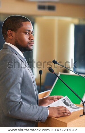 Serious or pensive young elegant delegate with papers Stock photo © pressmaster