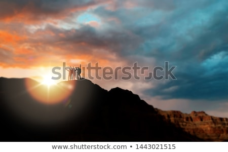 happy friends over grand canyon background Stock photo © dolgachov