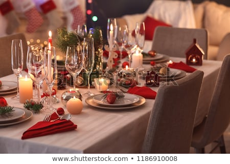 table served for christmas dinner at home stock photo © dolgachov