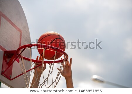 Hands of young basketball player throwing ball into basket during game Stock photo © pressmaster