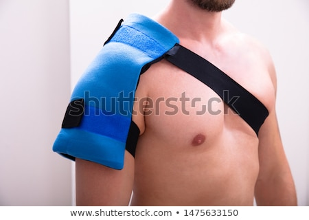 Man With A Ice Pack On His Shoulder Stock photo © AndreyPopov