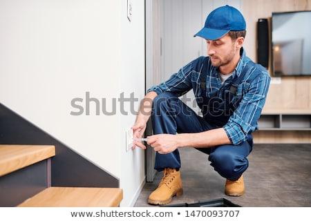 молодые электрик домашнее хозяйство обслуживание службе напряжение Сток-фото © pressmaster