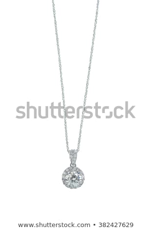 A beautiful diamond halo and white gold pendant dangles from a chain. Fine Jewelry necklace isolated Stock photo © serdechny