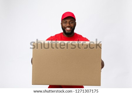 Portrait of young man carrying package boxes Stock photo © wavebreak_media