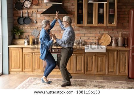 Idős pár ünnepek otthon nő fa szeretet Stock fotó © JackyBrown