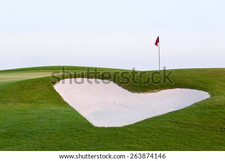 Sand bunker in front of golf green and flag Stock photo © backyardproductions