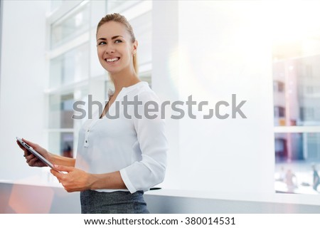 Businesswoman smiling while touching a tablet computer Stock photo © wavebreak_media